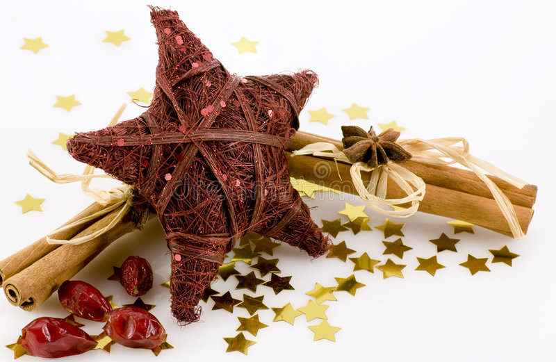 Christmas decoration. One red Star with cinnamon and rose-hips royalty free stock image