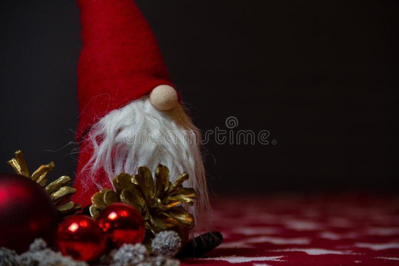 Traditional christmas decoration with an adorable little santa claus on dark background royalty free stock image