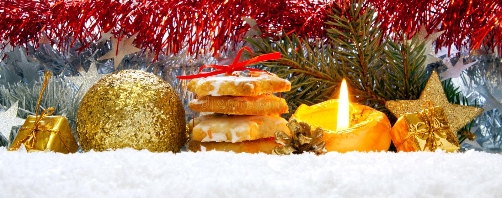 Christmas decoration and advent candle. Christmas cookies and decoration . Advent Candle royalty free stock image