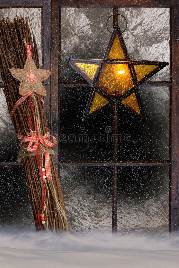 Christmas decoration, atmospheric window decoration. Christmas decoration, atmospheric decorated window with shining star stock image