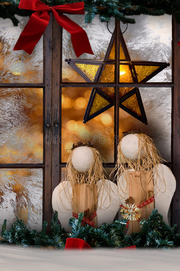 Christmas decoration, atmospheric window decoration with shining star. And two angles royalty free stock photo