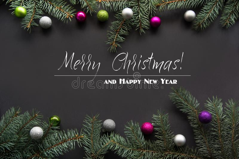 Christmas decoration background. Fir tree branches on black background with copy space. Top view. Pattern. Christmas or New Year decoration background. Fir tree royalty free illustration