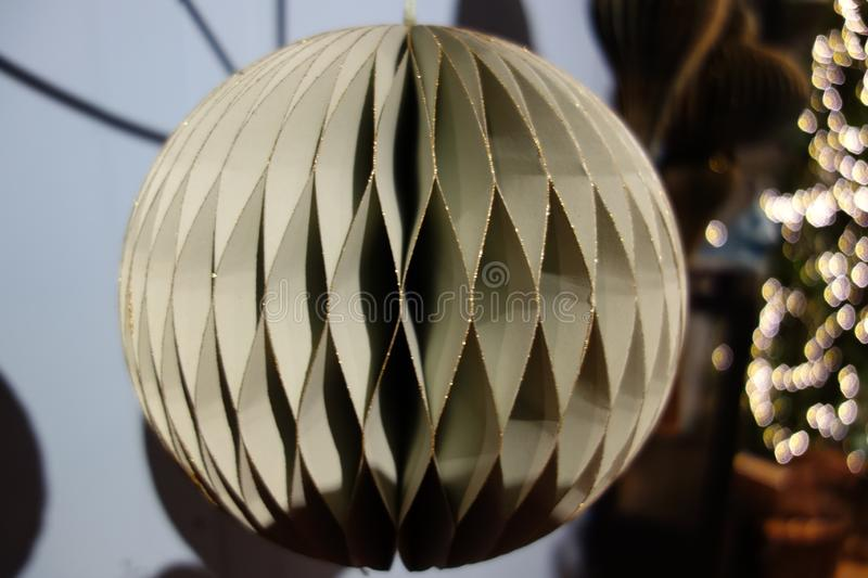 Christmas decoration, Christmas ball with lamellas of paper in aqua-menthe colour and gold. stock photo