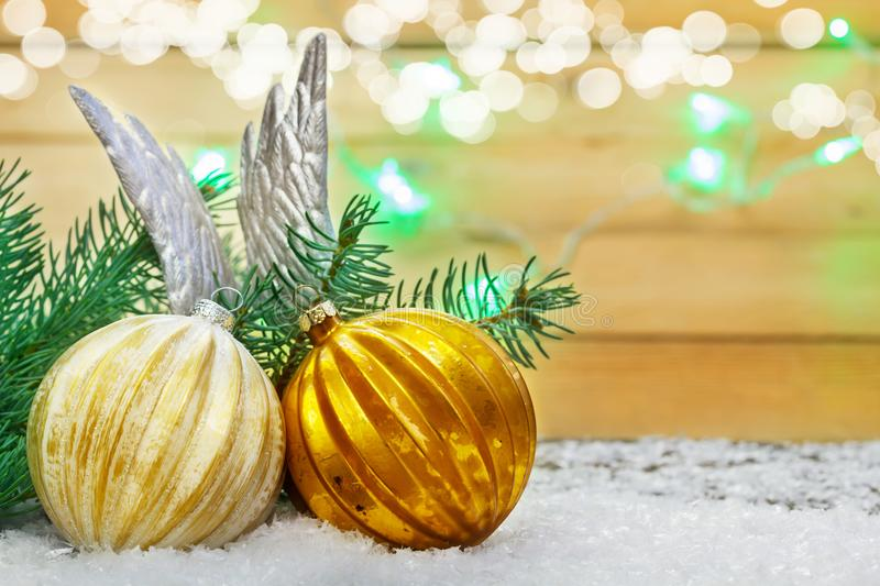 Christmas decoration, balls and Angel wings in the snow. Before fir stock image