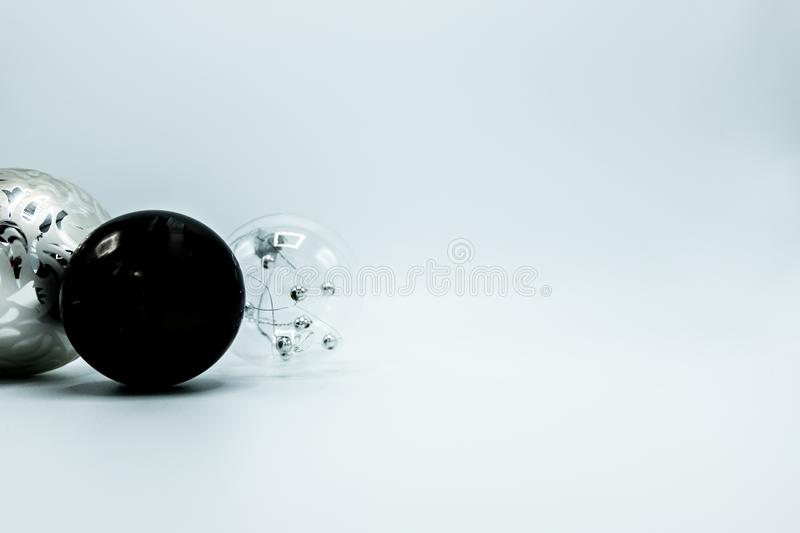 Christmas decoration balls in black, silver and transparent. Monochrome elegant Christmas wallpaper background of tree decorations. Classy holidays image in stock image