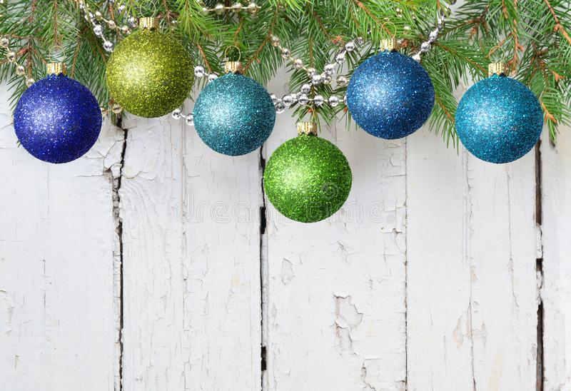 Christmas decoration balls, fir branches on a white wooden background, copy space, Christmas decoration, Merry Christmas stock photos