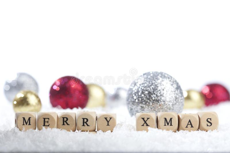 Christmas decoration balls and merry text stock