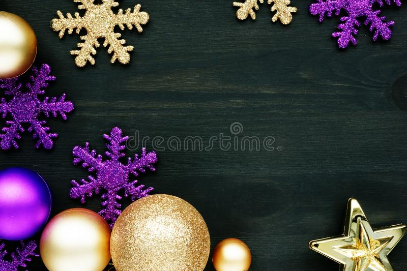Christmas decoration balls and snowflakes on dark wooden background with free space stock photos