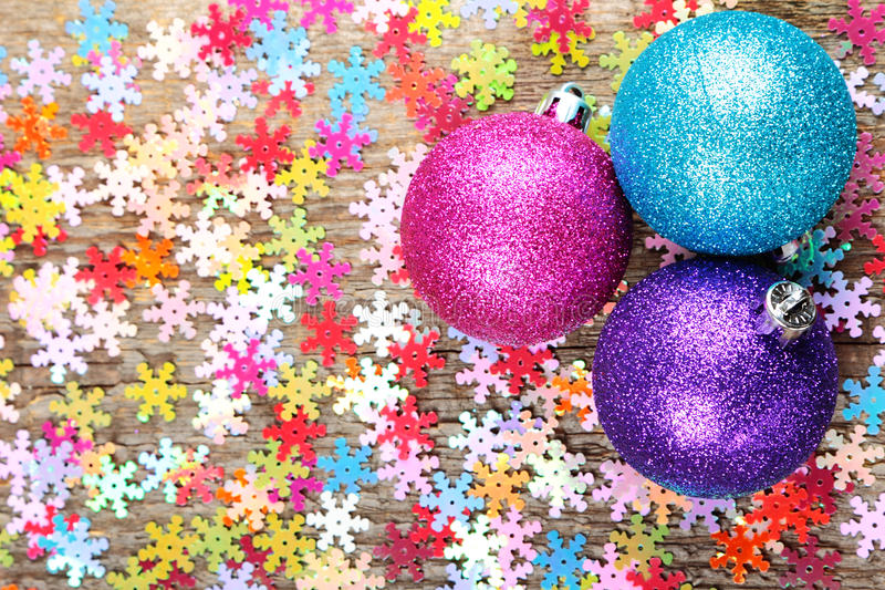 Christmas decoration. Christmas bauble with multicolored snowflakes on old wooden background stock images