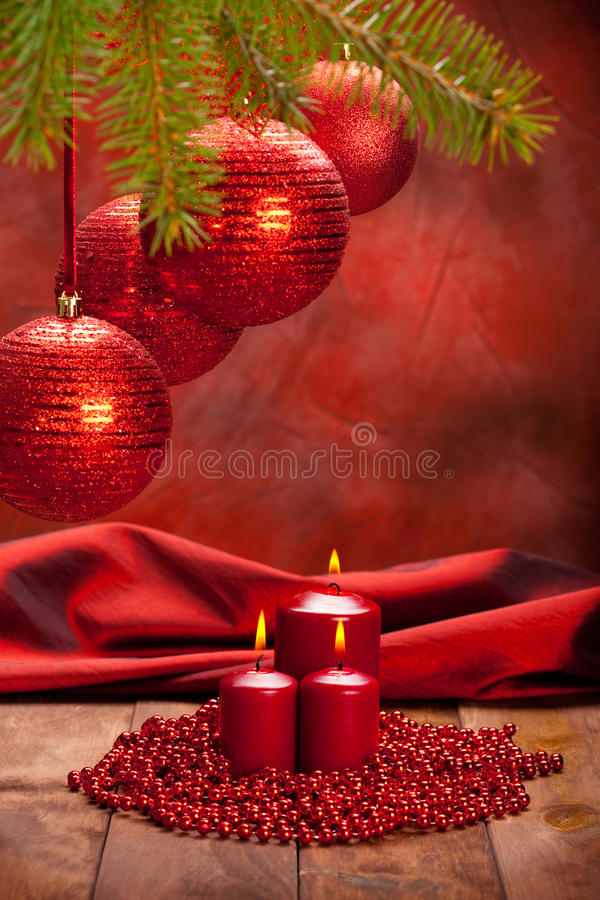 Christmas decoration - baubles and candles royalty free stock image