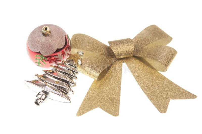 christmas balsl with gold ribbon bow on white background stock photos