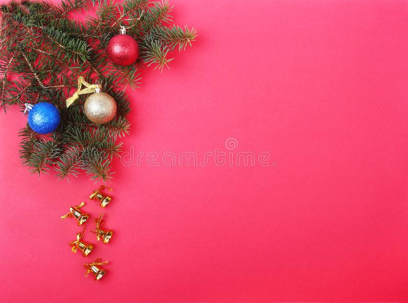 Christmas decoration with Beautiful gold bells, colorful balls and ribbons on red background. royalty free stock images