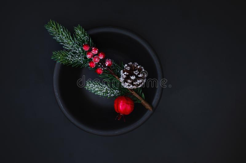 Christmas decoration with branches of fir tree on dark  background. Xmas tree, pine, winter festive Card. Top view. Copyspace stock images