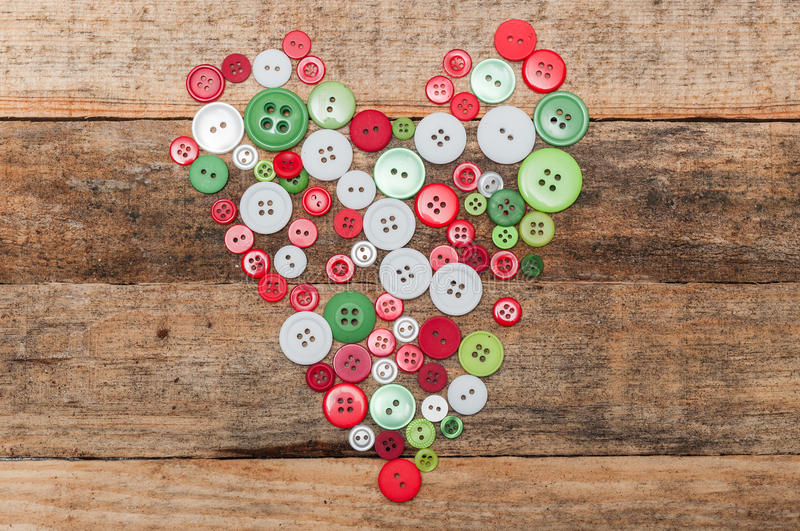 Christmas decoration. Buttons heart on wood background stock photography