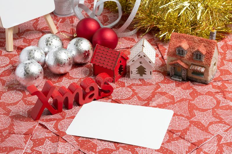 Christmas decoration and christmas card on the table. Christmas decoration and christmas card on the red napkin royalty free stock photography