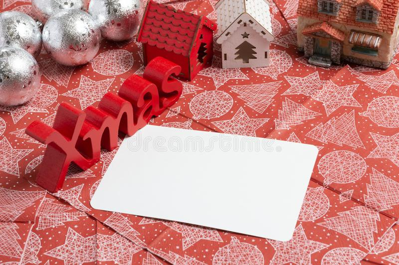 Christmas decoration and christmas card on the table. Christmas decoration and christmas card on the red napkin royalty free stock images