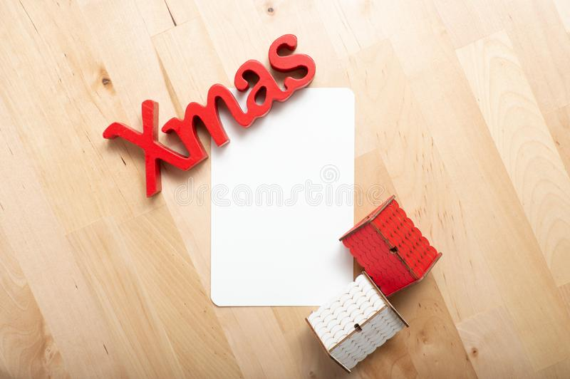 Christmas decoration and christmas card on the table. Christmas decoration and christmas card on the wood table stock photo