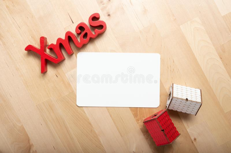 Christmas decoration and christmas card on the table. Christmas decoration and christmas card on the wood table royalty free stock photography