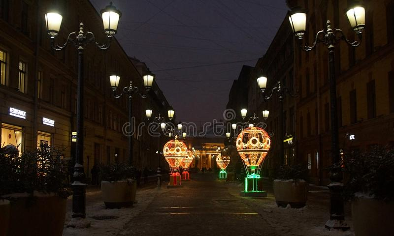 Christmas decoration of the city with electric glowing lights. Malaya Sadovaya Street in St. Petersburg stock photo