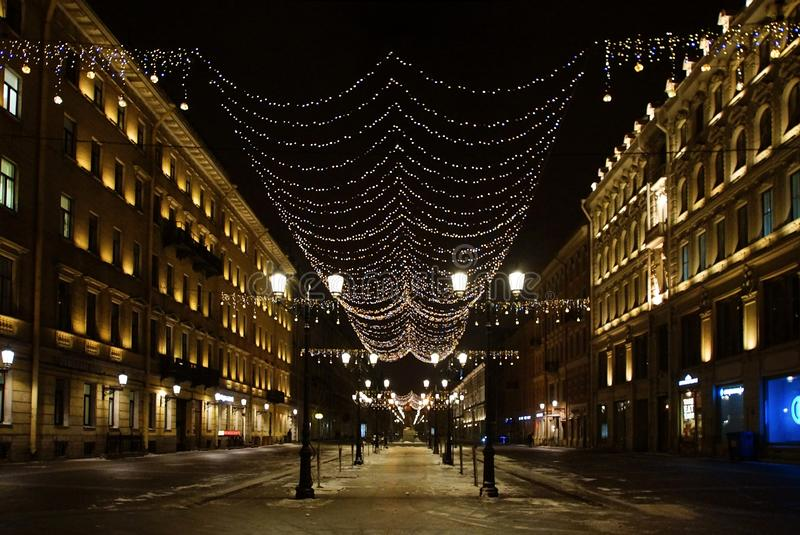 Christmas decoration of the city with electric glowing lights. Malaya Konyushennaya Street in St. Petersburg stock image