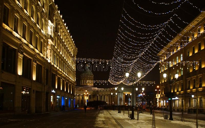 Christmas decoration of the city with electric glowing lights. Malaya Konyushennaya Street in St. Petersburg royalty free stock image