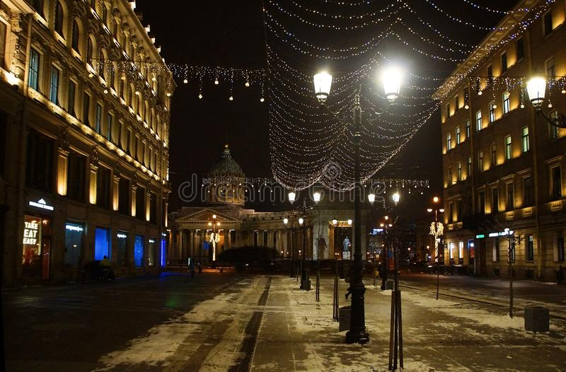 Christmas decoration of the city with electric glowing lights. Malaya Konyushennaya Street in St. Petersburg royalty free stock images