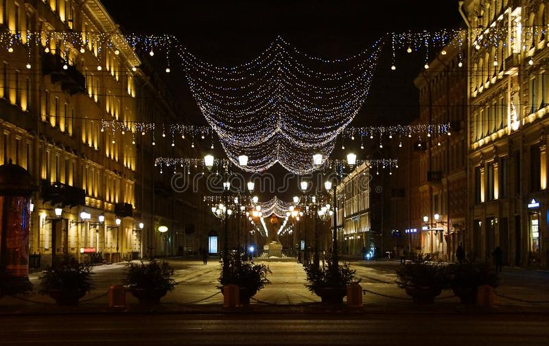Christmas decoration of the city with electric glowing lights. Malaya Konyushennaya Street in St. Petersburg royalty free stock photo