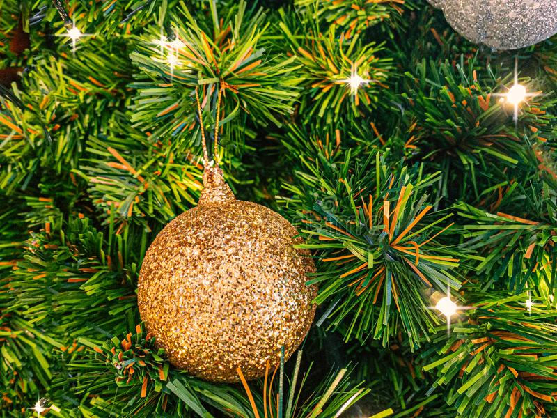 Christmas decoration composted for merry christmas. Christmas decoration composed of fresh fir branches and ornaments in golden royalty free stock image