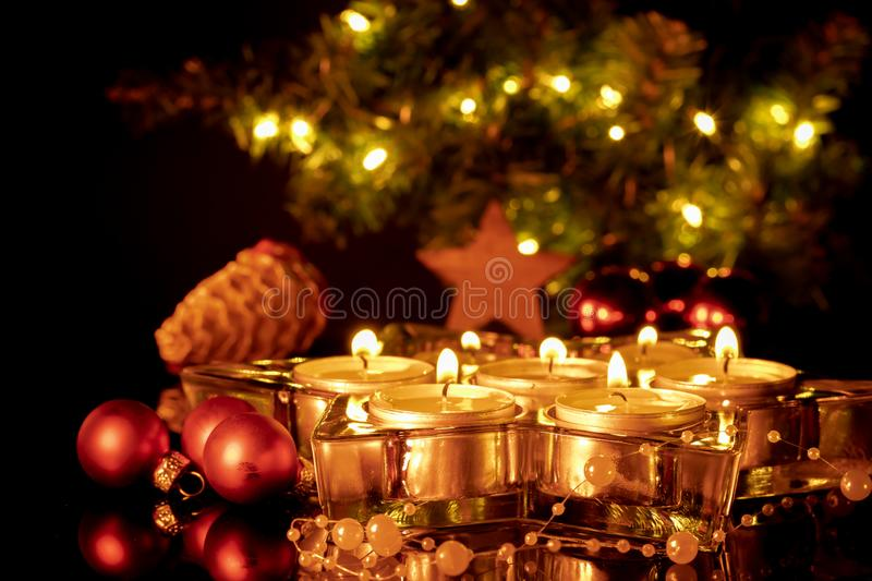 Group of burning candles and red balls royalty free stock image