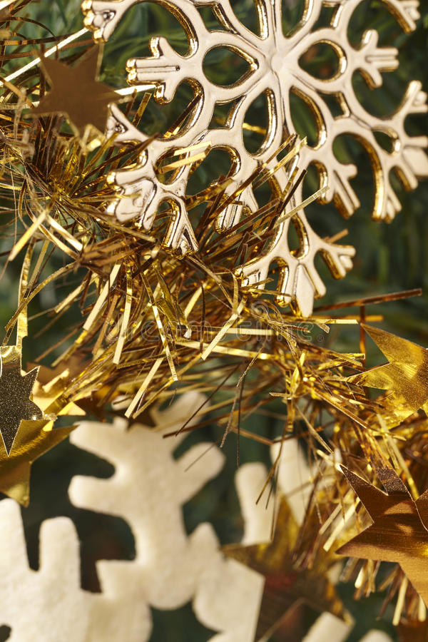Christmas decoration detail with golden stars and garland royalty free stock image