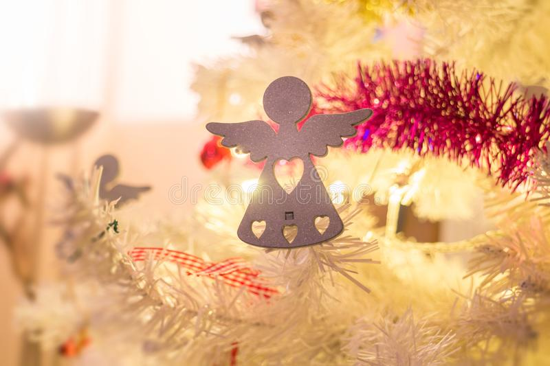 Christmas decoration details Angels. Christmas tree ornament Angel decoration close up detail with shining lights stock images