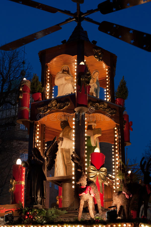 Christmas decoration with figures at night at Christmas market - Weihnachtsmarkt - in Stuttgart, Germany stock images