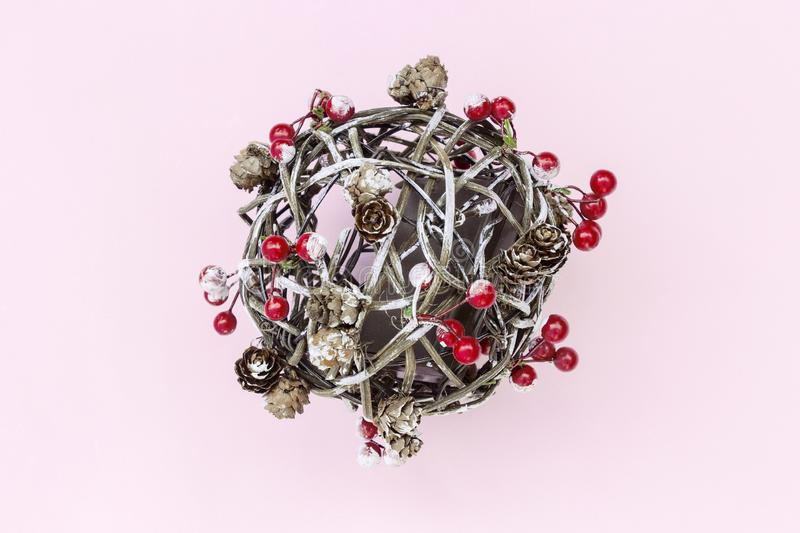 Christmas decoration - fir branches, red berries, balls, pine cones,  on pink background. Merry Christmas composition, New Year stock images