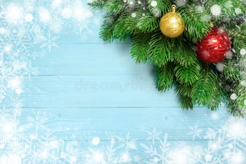 Christmas decoration with fir branches, snowflake on blue board wooden background with copy space stock photo