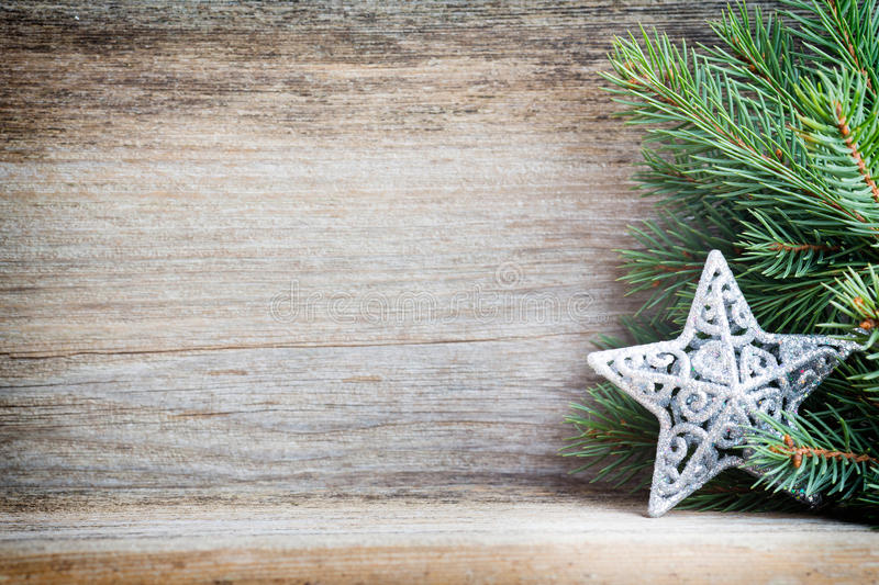 Christmas decoration with fir branches on the wood background. royalty free stock photos
