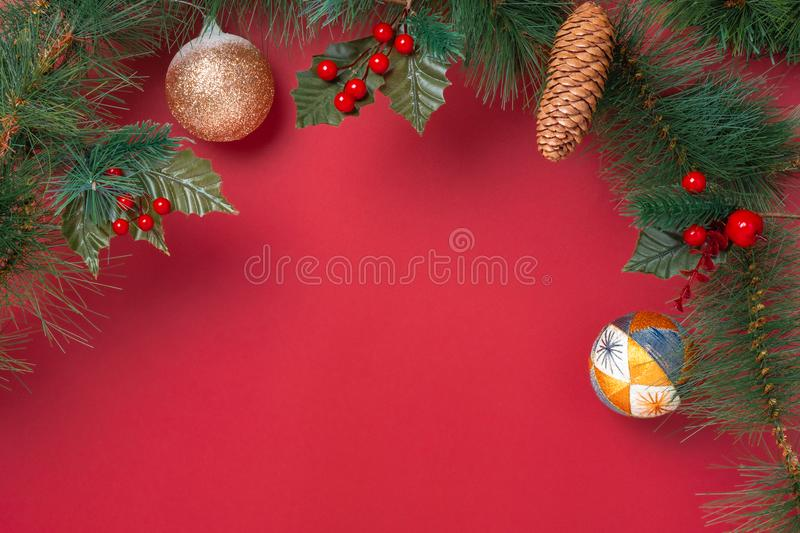 Christmas decoration and fir branches wreath with cherry and pin stock image