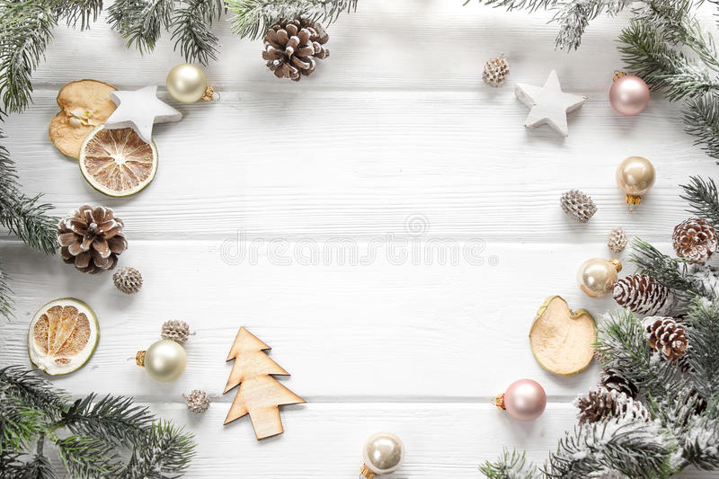 Christmas decoration of fir tree and conifer cone on wood background, top view. Copy space royalty free stock photos