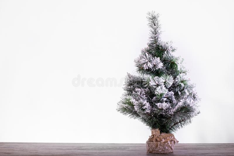 Christmas decoration, fir tree with red and silver balls and tinsel snowed stock photos