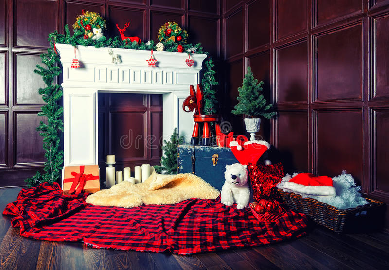 Christmas decoration with fireplace in the room royalty free stock photography