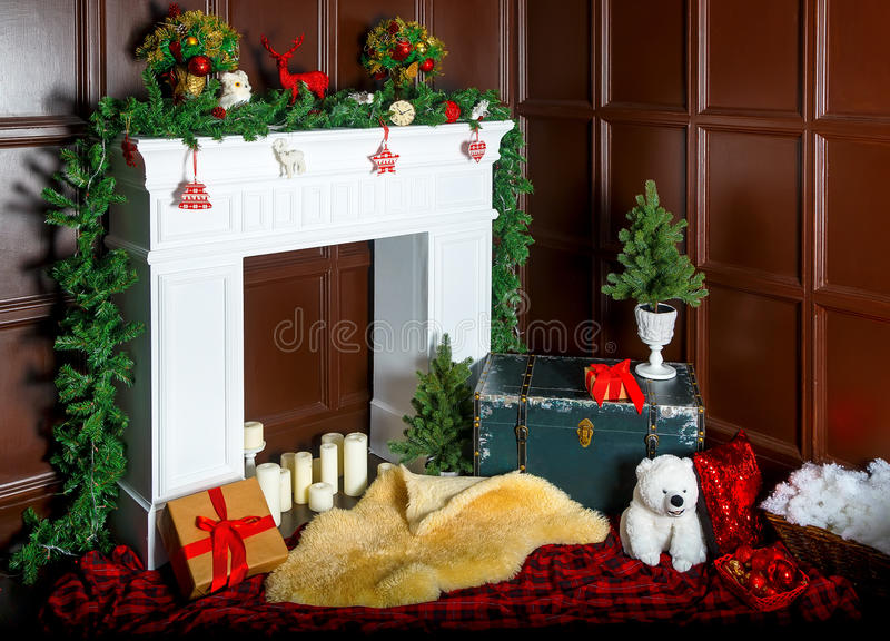 Christmas decoration with fireplace in the room stock photography
