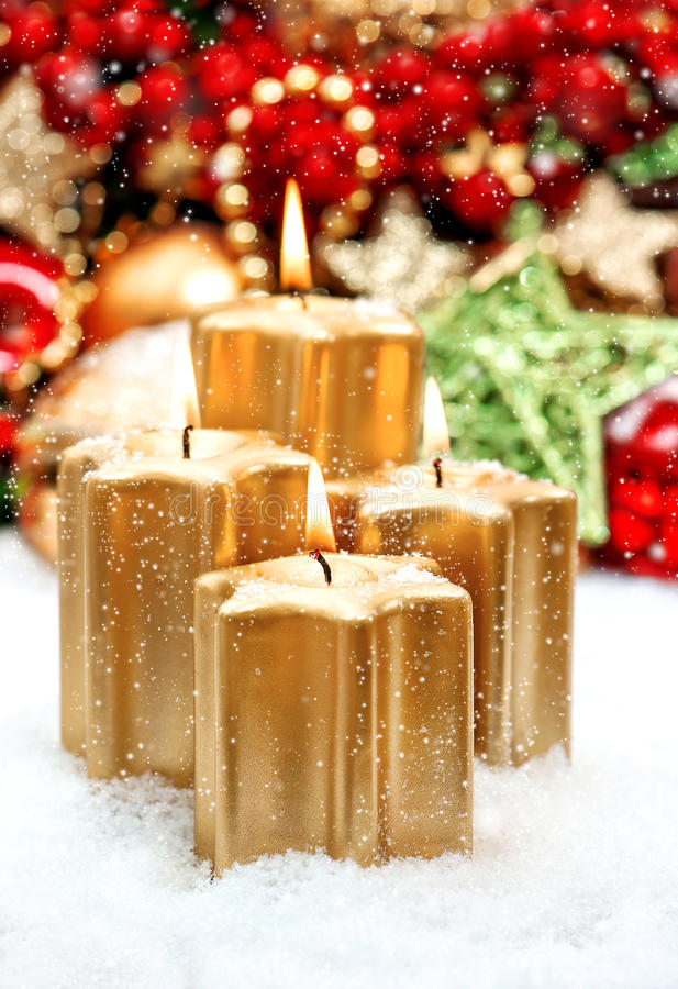 Christmas decoration with four golden burning candles royalty free stock images