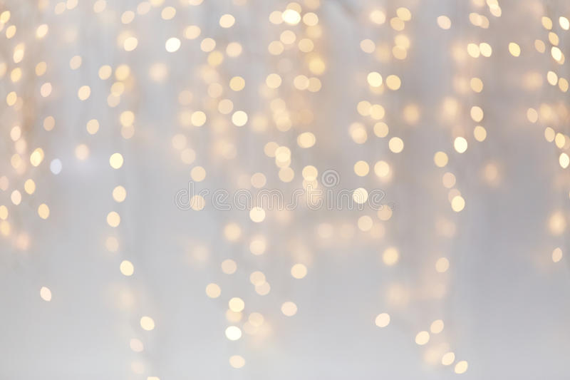 Christmas decoration or garland lights bokeh. Holidays, background and illumination concept - blurred golden christmas decoration or garland lights bokeh stock images