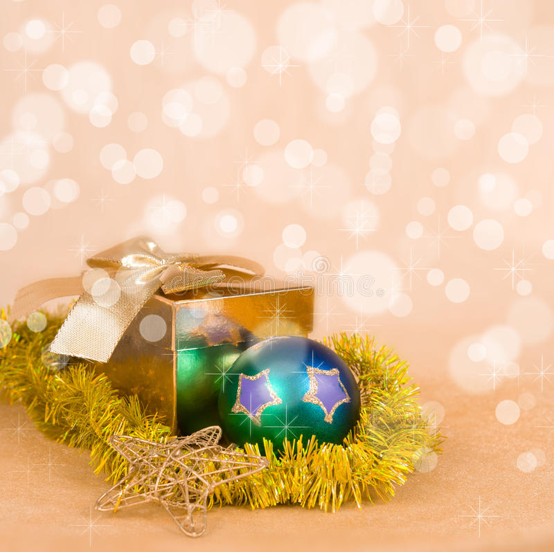 Christmas Decoration and gift box on a golden bokeh royalty free stock image