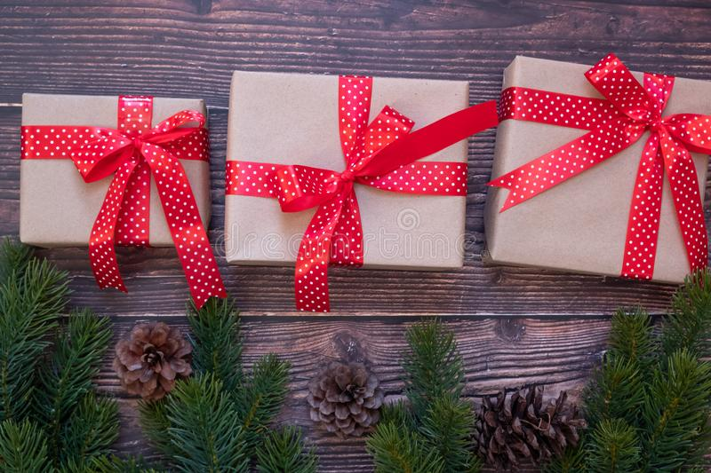 Christmas decoration, gift box and pine tree branches on wooden background, preparation for holiday concept royalty free stock photo