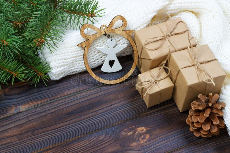 Christmas decoration, gift boxes and angel figure frame background, top view with copy space on white wood table surface. Christma royalty free stock photos
