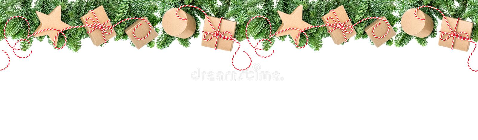 Christmas decoration gift boxes Pine branches border banner. Christmas decoration and gift boxes. Pine tree branches border on white background. Holidays banner royalty free stock photo