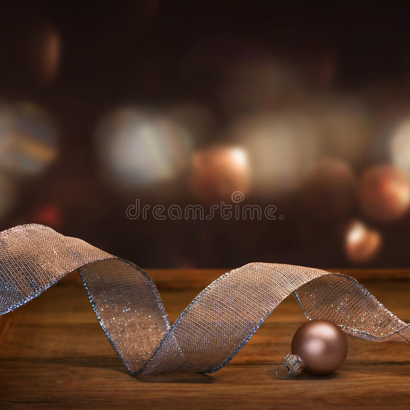 Christmas decoration with gift ribbon. In pink and silver in front of a abstract Background royalty free stock photos
