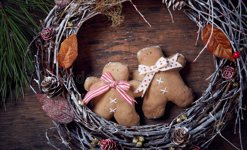 Christmas decoration. Gingerbread man, Christmas wreath. Dark background, top view. stock photo