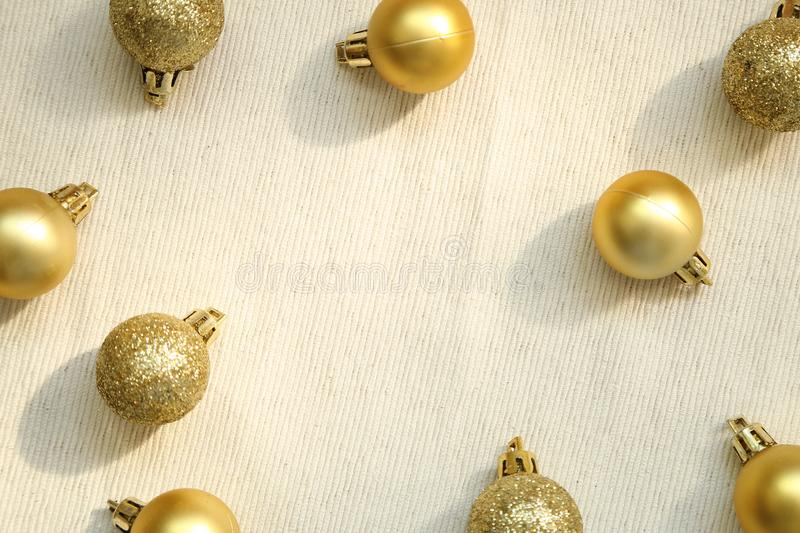 Christmas decoration gold baubles on fabric background stock photo
