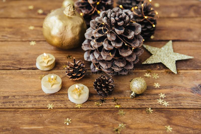Christmas decoration in gold over wooden background. stock photos